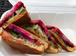 Veg-Wich Bombay Grill Sandwich:tomatoes, cucumber, green peppers, boiled potato, beets, cheese, butter and chutney on white bread