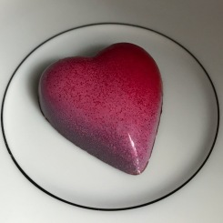 Chocolopolis Chocolate Raspberry Rose Heart dark chocolate shell with white chocolate ganache blended with raspberry puree and pink rose petals