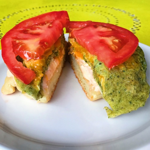 The Crumpet Shop: Rob's Favorite green egg, english cheese, tomato on smoked salmon spread
