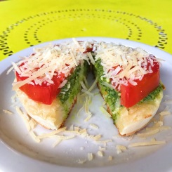 The Crumpet Shop: Pesto with fresh tomato and parmesan cheese on a crumpet