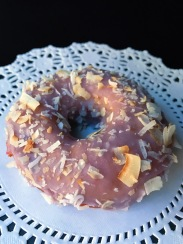 Raised Doughnuts Ube Coconut yeast raised doughnut with ube glaze and toasted coconut
