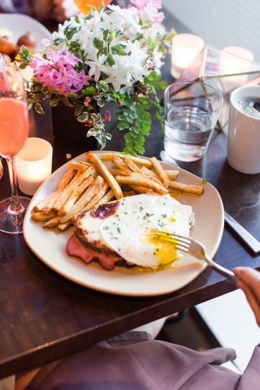 Croquet Madame: Beecher's flagship cheddar mornay, Hill's ham, local potato bread, over easy egg
